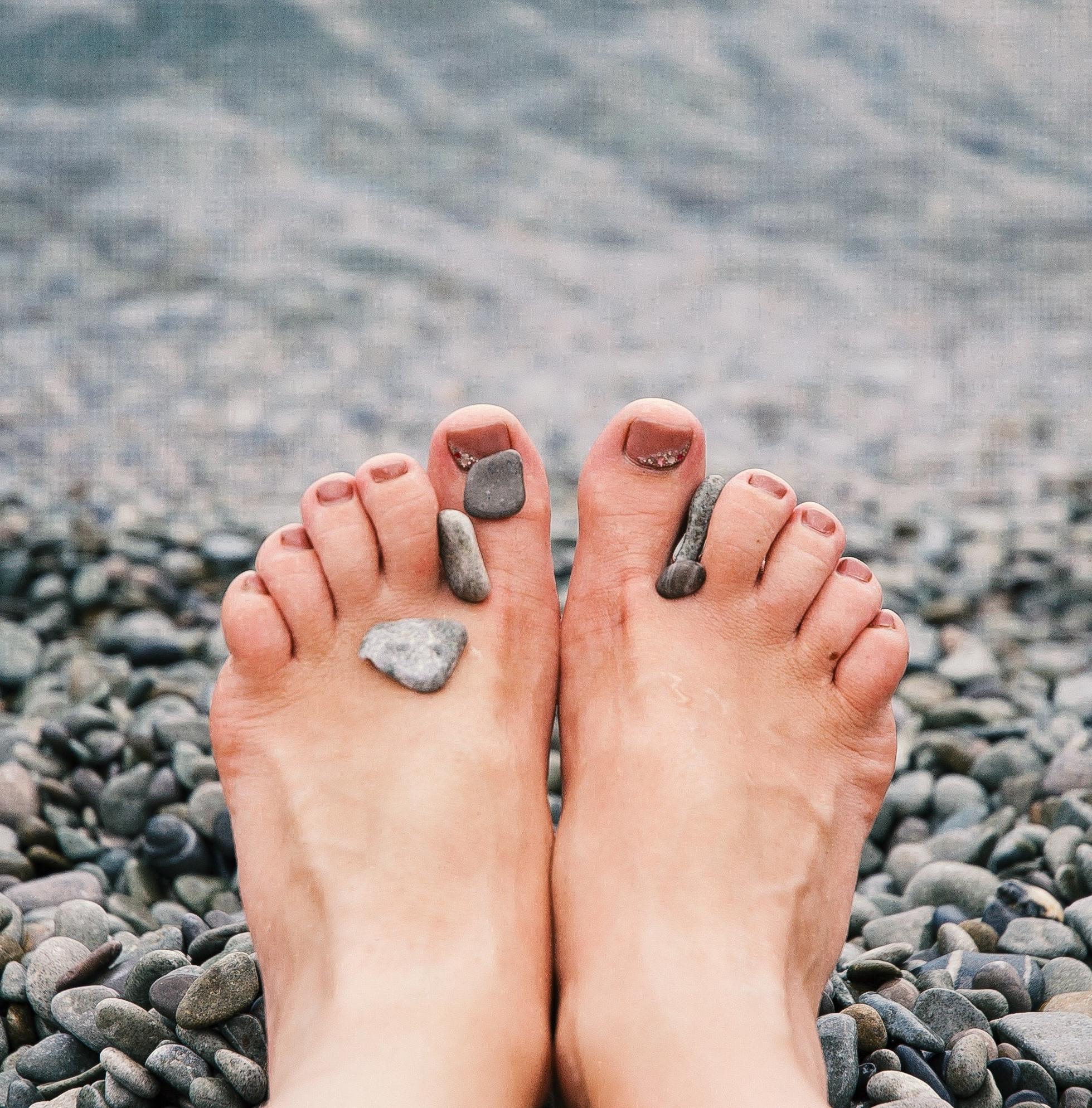 stones-on-woman-s-feet-1274061-min
